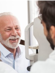 senior patient consulting with optician in office picture id899606214 225x300 1